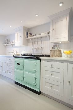 AGA Total Control 3 Aqua. Looking at this it seems really important to tie the oven in. Perhaps with black kickboards.