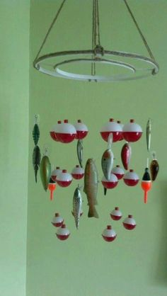 Bobber and fish mobile. (no link-just picture) Embroidery hoops spray painted white with jute twine hot-glued on. Bobbers hang from middle hoop and fishing lures hang on the outside hoop. Use Dads tackle and make for Trav. Fishing Nursery, Boy Fishing, Fishing Lures, Fishing Knots, Fishing Tips, Fishing Crafts, Boys Fishing Bedroom, Fishing Bobbers, Fishing Basics