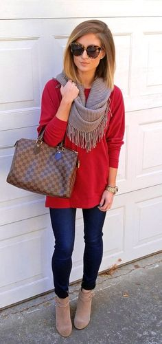 #fall #outfits woman's red long-sleeve shirt with gray scarf and blue fitted jeans with pair of suede boots