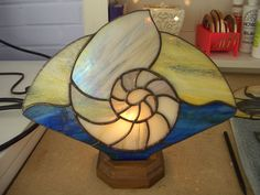 Stained Glass Iridescent Nautilus Shell Fan by AcadianGlassArt, $90.00