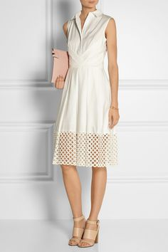 Lela Rose is known for her ultra feminine, hand-finished designs. Crafted from ivory poplin,this shirt dress has a cutoutlacehem and a pleated skirt. Perfect look to style with  pastel accessories, such as the Givenchy sandals and aVictoria Beckham clutch shown here.