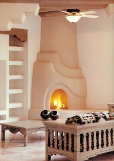 santa fe style fireplaces | ... fireplace made of adobe bricks covered with plaster the kiva fireplace