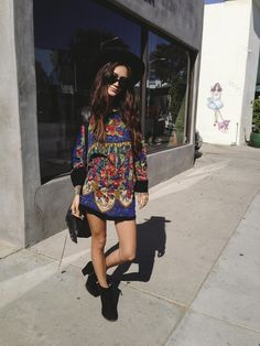Bold vintage tunic paired back with black ankle boots, cross body and wide brim. Edgy urban boho.
