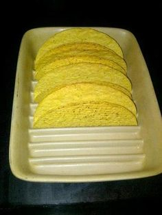 The Pampered Chef Small Ridged Baker is perfect for holding taco shells in place for filling! Kudos to whomever came up with this great idea! Visit my website @ www.pamperedchef.biz/bekahbruggman