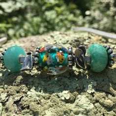 The NEW Deep Ocean Bead in the sun!  If you buy one you will get 25% off any Fantasy Neckalce! https://www.trollbeadsgallery.com/trollbeads-summer-release-2016/