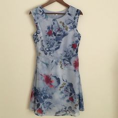 """Lavand Anthropologie M sleeveless blue floral Midi Stylish, Feminine, and flowing Lavand Anthropologie brand sleeveless summer blue floral dress. Dress features rounded neck with pleat in front for beautiful inverted v pleat detailing and side zipper.  Dress is fully lined with a sheer floral print fabric over the top and is a size medium. Dimensions: 34"""" bust x 28"""" waist 35"""" length. Anthropologie Dresses Midi"""