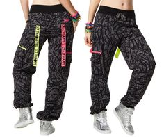 LET'S GLOW CARGO PANTS Turn cargo into car-glow with Let's Glow Cargo Pants! Enjoy roomy side pockets, adjustable length bungee cord stoppers and special br Zumba Fitness, Zumba Clothes, Zumba Outfit, Shops, Bungee Cord, Cute Boutiques, Cargo Pants, Granite, Parachute Pants