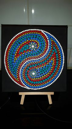 Colourful ying yang dot mandala on canvas by Suzanne Cannon.