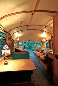 A rusty bus is transformed into a bohemian guest house
