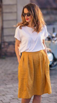 Mustard linen skirt with pleats, white tshirt, sunglasses