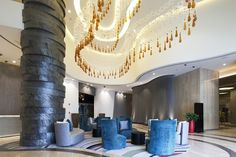 A wave in the lobby made of favourite organic shapes - plates and drops of hand-blown glass.