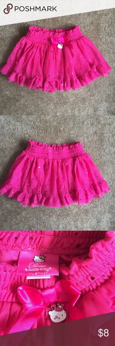 Hello Kitty Princess pretty hot pink tutu skirt 3T This is such a pretty Hello Kitty tutu mini skirt, will look lovely on your 3 year old princess! Elastic smocked waist, 2 layers of sparked mesh over knit lining inside. Cute satin bow at front waist with Hello Kitty head chain. Worn a few times but still in good condition. No runs, snags nor stains. Hello Kitty Bottoms Skirts