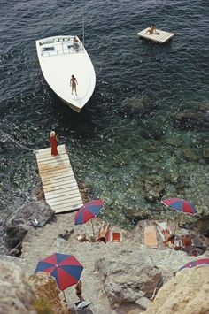 A Magnum motorboat belonging to Count Filippo Theodoli arrives at the private jetty of the Il Pellicano Hotel in Porto Ercole, Italy. August (Photo by Slim Aarons/Getty Images) Slim Aarons, Fine Art Photography, Photography Tips, Aerial Photography, Night Photography, Wedding Photography, Photography Triangle, Portrait Photography, Fashion Photography