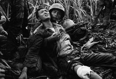 A South Vietnamese Marine, severely wounded in a Viet Cong ambush, is comforted by a comrade in a sugar-cane field at Duc Hoa, about 12 miles from Saigon, on August (Horst Faas/AP) ~ Vietnam War Vietnam History, Vietnam War Photos, Rare Pictures, Rare Photos, Famous Photos, Iconic Photos, World Press Photo, North Vietnam, Hanoi Vietnam