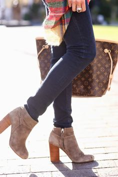 Tory Burch Booties Love the look of these boots w/skinny jeans. Would look so cute on you, Peanut!!