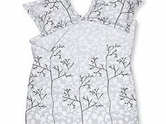 Bedding with a grey base, white designs and a brown/black tree.
