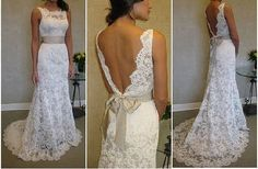 I absolutely adore lace wedding dresses. Love the scalloped back.