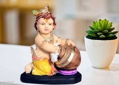 Religious Idols & Paintings Stylish Designer Home Decor Material:  Poly Resin & Marble Dust Size (L X W X H):  10.7 cm x 8 cm x 27.7 cm Description:  It Has 1 Piece Of  Krishna Statue Country of Origin: India Sizes Available: Free Size   Catalog Rating: ★4.3 (1627)  Catalog Name: Diva Stylish Designer Home Decor CatalogID_319047 C128-SC1316 Code: 962-2385867-555