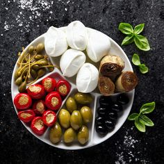 pletter appetizer of green olives, black olives, capers, buffalo #Plater #Appetizer #Olives #Food #Photography #Foodphotography