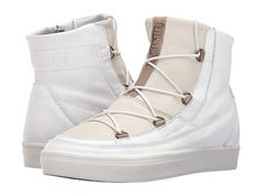 Tecnica Moon Boot Vega Lux-  I had  a pair similar to these  except  they  zipped  up and  were khaki canvas  with white heel.  Moon boots