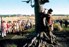 In a re-enactment that signified the end of the Lewis and Clark Bicentennial from 2004 to 2006, an actor portraying Capt. William Clark pretends to carve his initials in a bronze tree on the northernmost portion of Long Beach Peninsula's Discovery Trail.