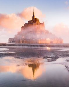 Mont Saint-Michel seems to magically arise out of the ground in France Le Mont St Michel, Scenic Photography, Sunrise Photography, Destination Voyage, Seven Wonders, Beautiful Places To Travel, Destinations, Family Travel, Places To See