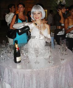 J & D Entertainment silver champagne strolling diva.  Happy New Year! Houston living table, human table