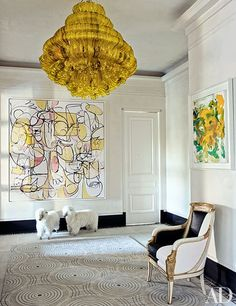 A Jacopo Foggini light fixture from Bernd Goeckler Antiques hangs in the entrance hall, which boasts paintings by George Condo (left) and Joan Mitchell as well as '60s French sheep otto mans from John Salibello Antiques and an Empire bergère (covered in a Stark leather) from Newel.