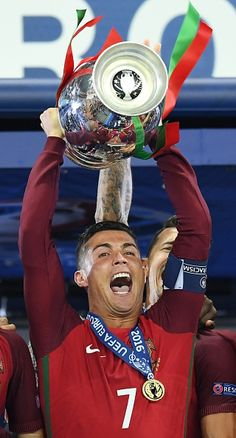 #EURO2016 Portugal's forward Cristiano Ronaldo celebrates with the trophy as he…