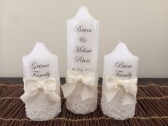 Beautiful wedding unity candles with ivory beaded lace & satin bow.   Visit http://facebook.com/moderndesigns1 to see more products in my albums