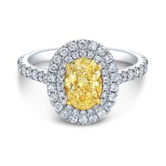 Ok I LOVE this! The yellow diamond is so pretty and unique, but the band is delicate and classy.