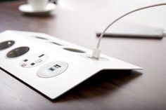 """PEAK with its eye-catching """"floating surface"""" design, provides power & data connectivity to meeting tables. Choose PEAK in classic brushed stainless steel with black sockets or in matt white with grey sockets for a more contemporary look.  #stylish #indesk #power #socket #plugs #USB #charger #interiors #conference #meeting #table"""