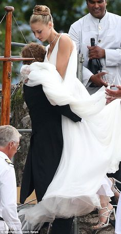 To have and to hold: Stunning Italian heiress Beatrice Borromeo is given a helping hand by her royal groom Pierre Casiraghi ahead of ceremony at her parents' lakeside castle