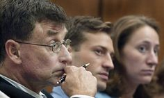 Michael Peterson, left, alongside his son, Todd Peterson, and adopted daughter, Margaret Ratliff, listen to a hearing after trial.