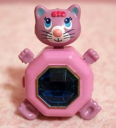 Sweet Secrets toys changed from jewels into dolls, capturing girl's hearts. This one is the cleverly named Cat Trina.