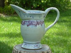 Stoneware, wheel thrown and altered pitcher by Shelley Duncan