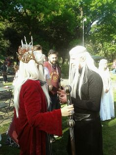 A Thranduil with: red cloak, tiara snd staff. Another Thranduil with: grey dress and crown
