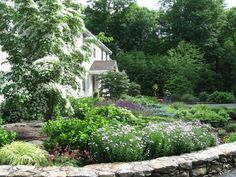 Gorgeous! Rock wall and landscaping by Designing Eden in CT.