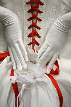Red on white corset with gloves.