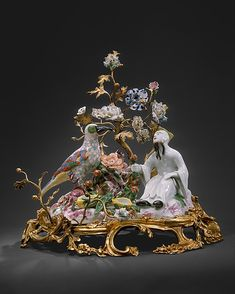 Chinaman with Bird, ca. 1727  Germany, att. George Fritzsche (1698–1756, working at Meissen from 1711)   Hard-paste porcelain with gilt-bronze mounts and soft-paste porcelain flowers. mounts French and flowers Vincennes, ca. 1750  H. 30.5 cm  New York, Metropolitan of Art, 1982.60.256