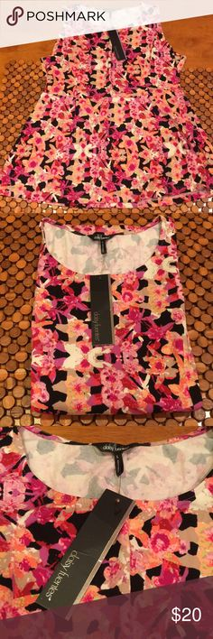 Daisy Fuentes Top - NWT size L Perfect for vacation! Cotton Daisy Fuentes top in gorgeous colors, cute trendy style. New, with tags. My sister buys things then never wears them. Tag reads 95% cotton 4% spandex. Travels well, doesn't seem to get wrinkly. Daisy Fuentes Tops Blouses