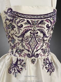 Evening dress, detail of the bodice, by Antonio Cánovas del Castillo (1908-84). Silk zibeline and embroidered chenille. Paris, France, 1957    More great detail shots on site