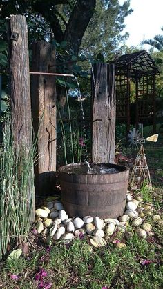 We had great fun designing this water-feature using railway sleepers and an old wine-barrel