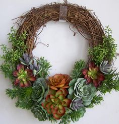 Thanks so much for stopping by and visit my creations. All my wreath is unique and created in highest quality. This lovely faux succulent door wreath sets on a nature grapevine wreath base. The wreath is embellished with beautiful green, orange,dark green , light green faux succulents. This wreath will never need water or pruning ! The wreath measures from tip to tip at 17 (L) x 16 (W) x 5(D). This wreath can be customized to match your home decoration. The wreath needs to be placed in a…