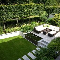 This contains the elements you want. Lawn, dining area, and planting.