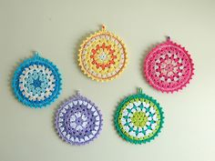 Some call them potholders and others call them mandalas. I think I shall make some.