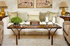 Coffee tables: Southern style decorating expert Phoebe Howard offers foolproof formulas for arranging items on coffee tables in her new Southern Living magazine column - Daily Press