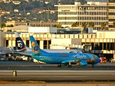 Alaska air lines disney - Tinker Belle jet checked out by the Hawaiian Nanook logo jet