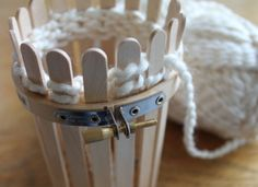 Popsicle stick loom knitting -For when I can't find a 12 peg loom! So easy! Popsicle Stick Crafts, Craft Stick Crafts, Yarn Crafts, Popsicle Sticks, Loom Patterns, Knitting Patterns, Crochet Patterns, Spool Knitting, Knitting Looms
