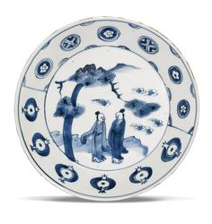 A BLUE AND WHITE KOSOMETSUKE DISH TIANQI MARK AND PERIOD  the conical sides supported on a tapering foot, the interior painted with two scholars under a pine tree in a landscape, all encircled by a geometric floral band, the base with a four-character mark within a double-circle, Japanese wood box D. 20.8cm.
